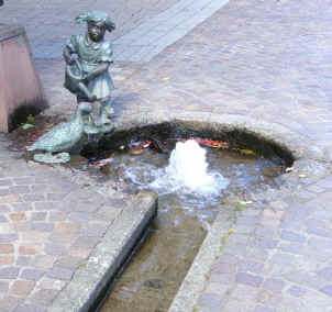 Hausach - statue and stream on pavement