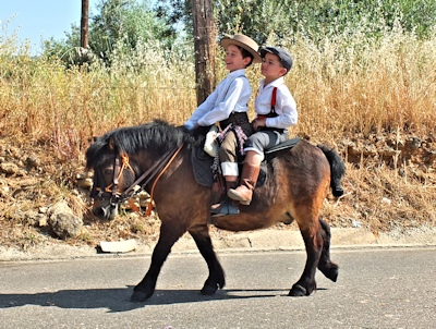 two lads on a donkey